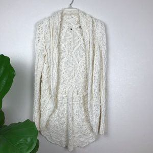 Knitted and knotted knit pom pom open cardigan